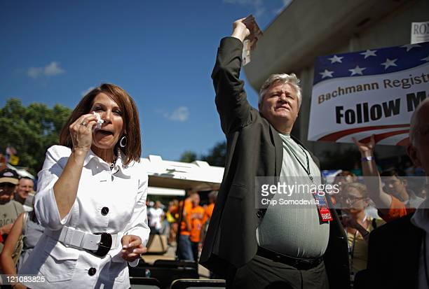Republican presidential candidate Rep Michele Bachmann and her husband Marcus Bachmann encourage people to vote for her outside the Hilton Coliseum...