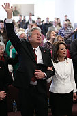 Republican presidential candidate Rep Michele Bachmann and her husband Marcus sing and pray while attending services at the Jubilee Family Church...