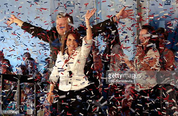 Republican presidential candidate Rep Michele Bachmann her husband Marcus Bachmann and some of their children wave to supporters as confetti rains...