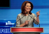 Republican presidential candidate Rep Michele Bachmann takes the stage for a debate in the Stephens Auditorium at Iowa State University August 11...