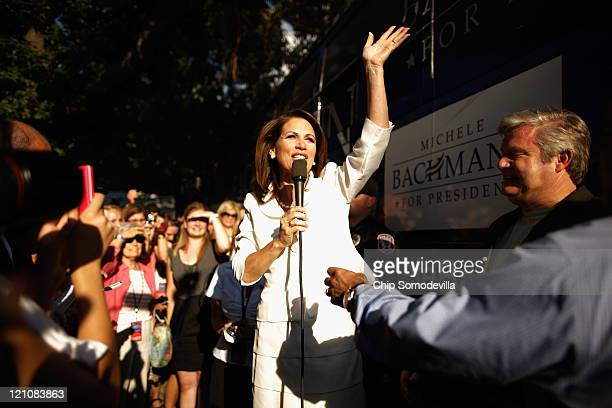 Republican presidential candidate Rep Michele Bachmann talks to the news media and her supporters after winning the Iowa Straw Poll outside the...