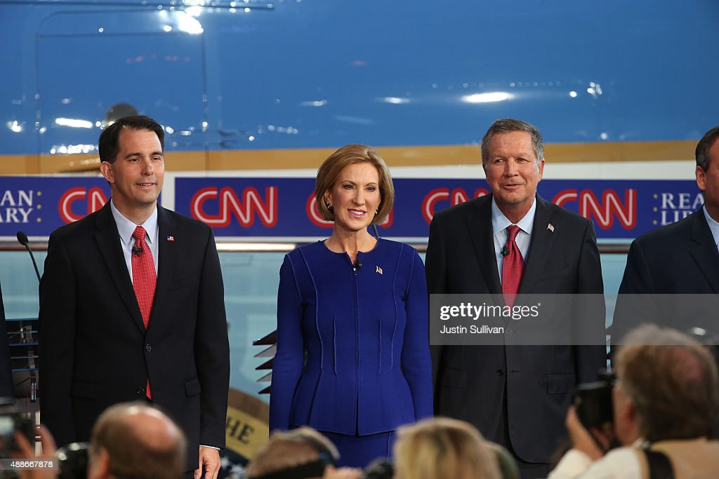 Republican presidential candidate Scott Walker Carly Fiorina and John Kasich take part in the presidential debates at the Reagan Library on September...