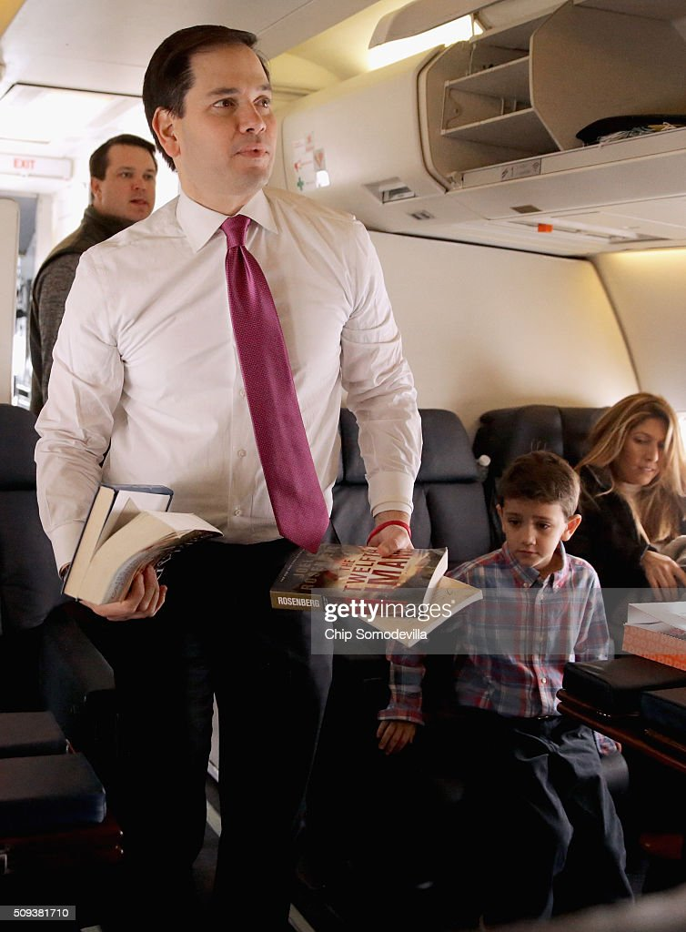 Republican presidential candidate Sen Marco Rubio and his family board their chartered plane before departing from ManchesterBoston Regional Airport...