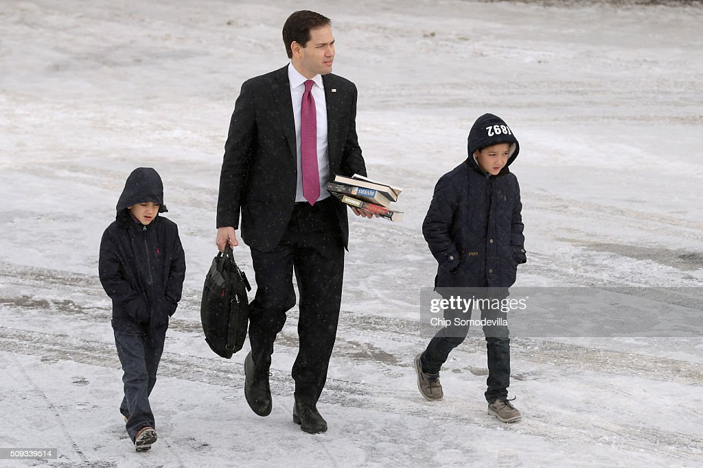 Republican presidential candidate Sen. <a gi-track='captionPersonalityLinkClicked' href=/galleries/search?phrase=Marco+Rubio+-+Politician&family=editorial&specificpeople=11395287 ng-click='$event.stopPropagation()'>Marco Rubio</a> (R-FL) and his sons Anthony and Dominick walk across the tarmac before departing from Manchester-Boston Regional Airport February 10, 2016 in Manchester, New Hampshire. Rubio placed fifth in the New Hampshire primary, behind fellow GOP candidates Jeb Bush, John Kasich, Sen. Ted Cruz (R-TX) and Donald Trump, who swept away the competition with 35-percent of the vote.
