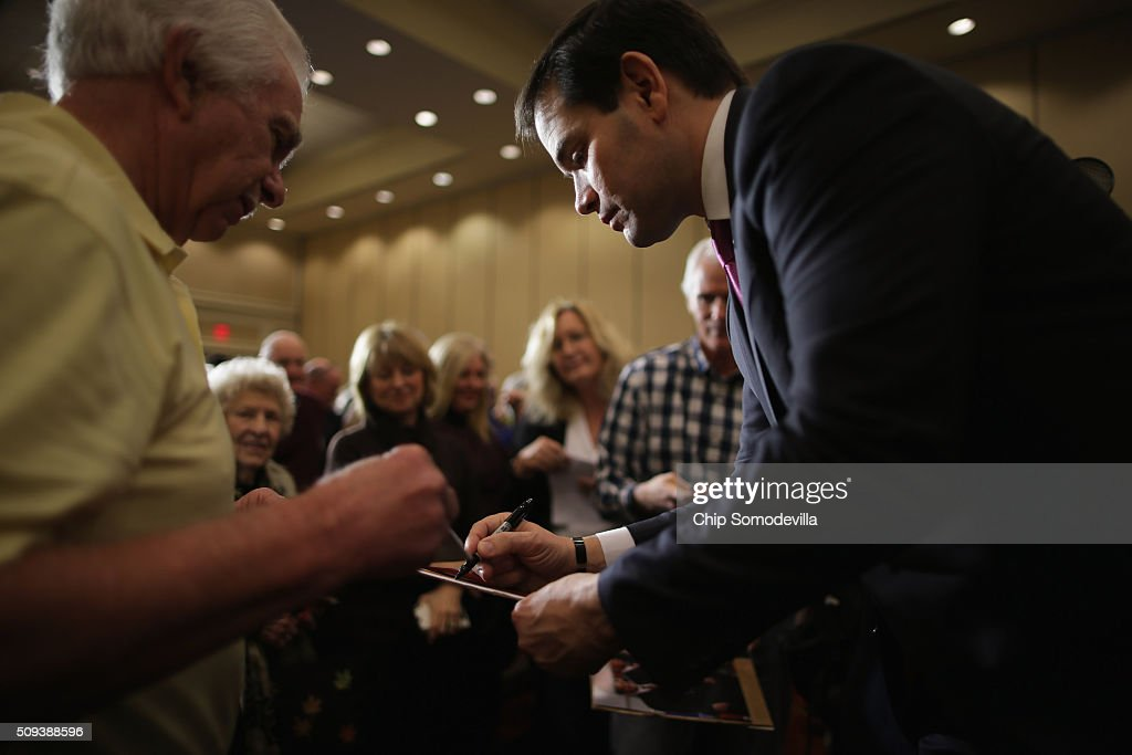 Republican presidential candidate Sen. <a gi-track='captionPersonalityLinkClicked' href=/galleries/search?phrase=Marco+Rubio+-+Politician&family=editorial&specificpeople=11395287 ng-click='$event.stopPropagation()'>Marco Rubio</a> (R-FL) gives autographs during a campaign rally at the Marriott hotel February 10, 2016 in Spartanburg, South Carolina. Rubio placed fifth in the New Hampshire primary, behind fellow GOP candidates Jeb Bush, John Kasich, Sen. Ted Cruz (R-TX) and Donald Trump, who swept away the competition with 35-percent of the vote.