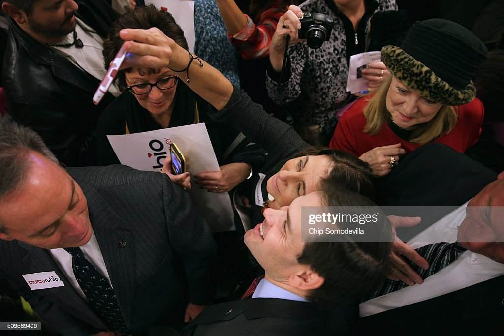 Republican presidential candidate Sen. <a gi-track='captionPersonalityLinkClicked' href=/galleries/search?phrase=Marco+Rubio+-+Politician&family=editorial&specificpeople=11395287 ng-click='$event.stopPropagation()'>Marco Rubio</a> (R-FL) gives autographs, poses for photographs and greets people during a campaign town hall meeting at the Crown Reef Beach Resort February 11, 2016 in Myrtle Beach, South Carolina. Earlier in the week Rubio placed fifth in the New Hampshire primary, behind fellow GOP candidates Jeb Bush, John Kasich, Sen. Ted Cruz (R-TX) and Donald Trump, who won with 35 percent of the vote.