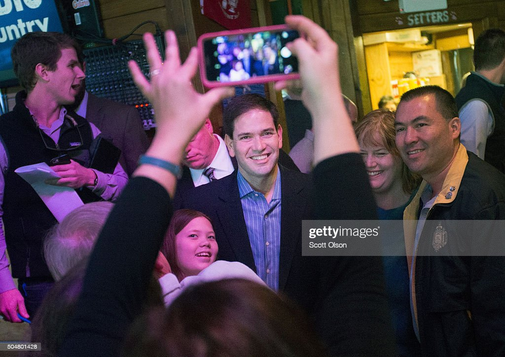 Republican presidential candidate Sen. <a gi-track='captionPersonalityLinkClicked' href=/galleries/search?phrase=Marco+Rubio+-+Politician&family=editorial&specificpeople=11395287 ng-click='$event.stopPropagation()'>Marco Rubio</a> (R-FL) greets guests during a campaign rally at the Water Dog Grill on January 13, 2016 in Mount Pleasant, South Carolina. Tomorrow Rubio will join other candidates seeking the Republican nomination for president for a debate at the North Charleston Coliseum and Performing Arts Center in North Charleston, S.C..