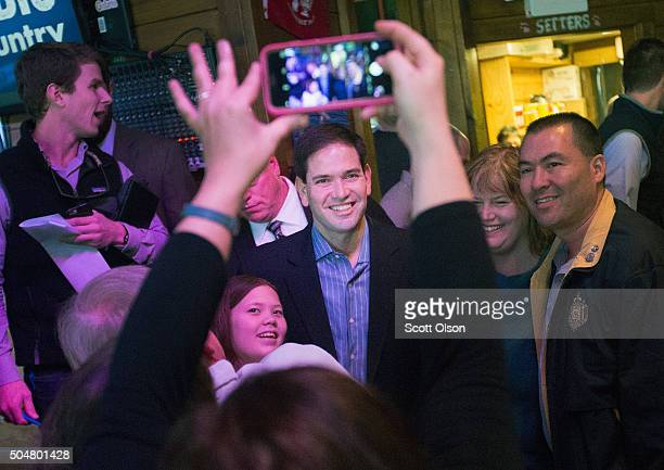 Republican presidential candidate Sen Marco Rubio greets guests during a campaign rally at the Water Dog Grill on January 13 2016 in Mount Pleasant...