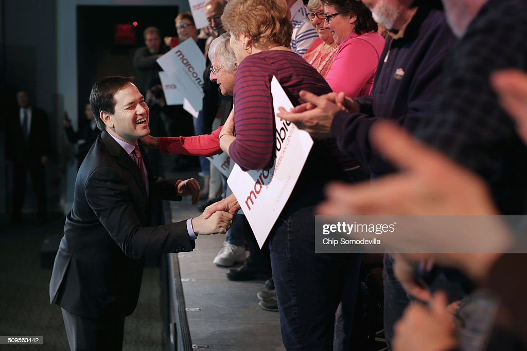 Republican presidential candidate Sen. <a gi-track='captionPersonalityLinkClicked' href=/galleries/search?phrase=Marco+Rubio+-+Pol%C3%ADtico&family=editorial&specificpeople=11395287 ng-click='$event.stopPropagation()'>Marco Rubio</a> (R-FL) greets people as he arrives for a campaign town hall meeting at the Sun City Hilton Head's Magnolia Hall February 11, 2016 in Okatie, South Carolina. Earlier in the week Rubio placed fifth in the New Hampshire primary, behind fellow GOP candidates Jeb Bush, John Kasich, Sen. Ted Cruz (R-TX) and Donald Trump, who won with 35 percent of the vote.