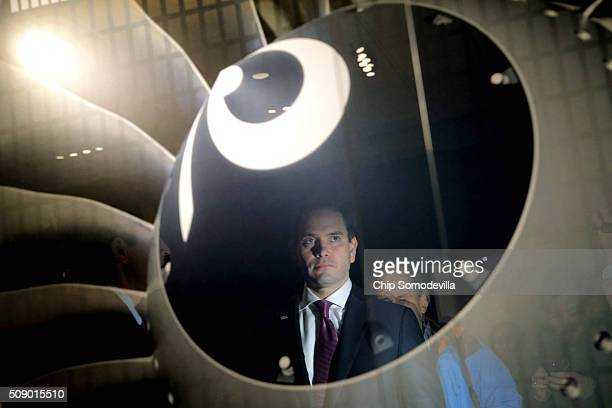 Republican presidential candidate Sen Marco Rubio is reflected in a display case while getting a tour of BAE Systems during a campaign stop February...
