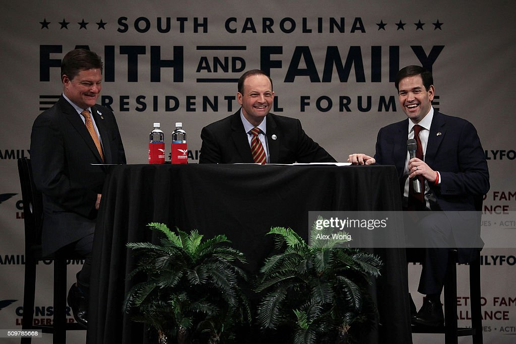 Republican presidential candidate Sen. Marco Rubio (R-FL) (R) participates in the South Carolina Faith and Family Presidential Forum with moderators, South Carolina Attorney General Alan Wilson (2nd R) and Oran Smith (L), February 12, 2016 in Greenville, South Carolina. Four Republican candidates joined the forum as they continued to campaign in the Palmetto State.