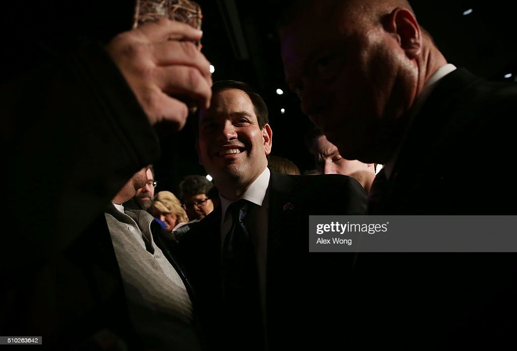 Republican presidential candidate Sen. <a gi-track='captionPersonalityLinkClicked' href=/galleries/search?phrase=Marco+Rubio+-+Politician&family=editorial&specificpeople=11395287 ng-click='$event.stopPropagation()'>Marco Rubio</a> (R-FL) poses for a selfie with a voter during a campaign rally February 14, 2016 in Easley, South Carolina. Rubio continued to campaign in the Palmetto State for the upcoming GOP primary.