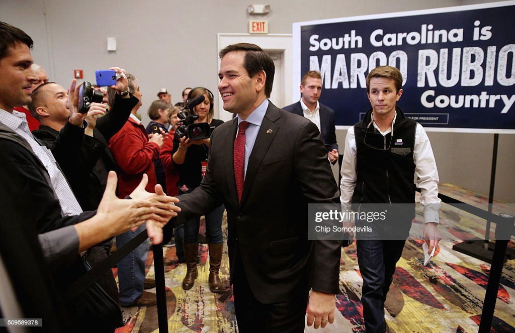Republican presidential candidate Sen. <a gi-track='captionPersonalityLinkClicked' href=/galleries/search?phrase=Marco+Rubio+-+Politician&family=editorial&specificpeople=11395287 ng-click='$event.stopPropagation()'>Marco Rubio</a> (R-FL) shakes hands as he arrives for a campaign town hall meeting at the Crown Reef Beach Resort February 11, 2016 in Myrtle Beach, South Carolina. Earlier in the week Rubio placed fifth in the New Hampshire primary, behind fellow GOP candidates Jeb Bush, John Kasich, Sen. Ted Cruz (R-TX) and Donald Trump, who won with 35 percent of the vote.