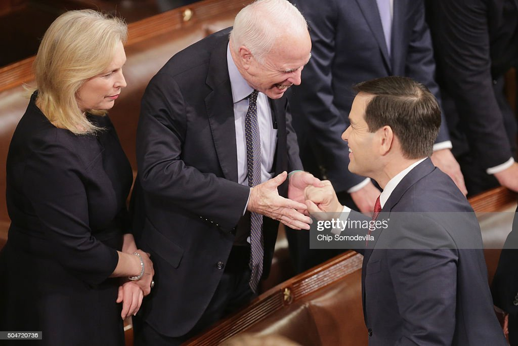 Republican presidential candidate Sen Marco Rubio shakes hands with Senator John McCain as Sen Kirsten Gillibrand looks on before US President Barack...
