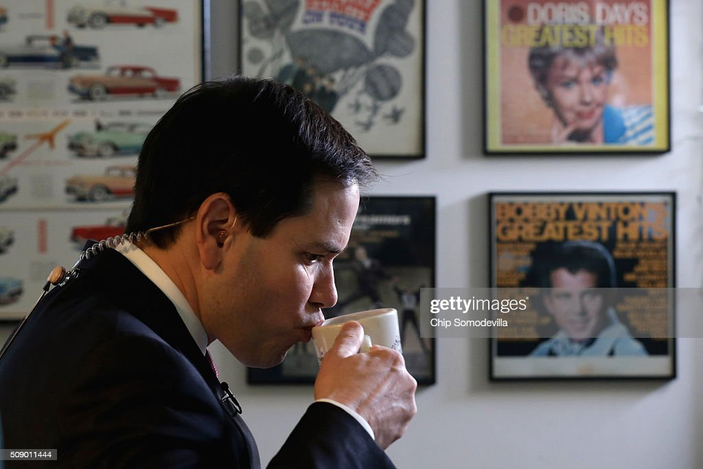 Republican presidential candidate Sen. <a gi-track='captionPersonalityLinkClicked' href=/galleries/search?phrase=Marco+Rubio+-+Politiker&family=editorial&specificpeople=11395287 ng-click='$event.stopPropagation()'>Marco Rubio</a> (R-FL) sips coffee before doing a television interview at Norton's Classic Cafe during a campaign stop February 8, 2016 in Nashua, New Hampshire. Rubio is hoping for a good showing on Tuesday when people in New Hampsire head to the polls in the 'First in the Nation' presidential primary.