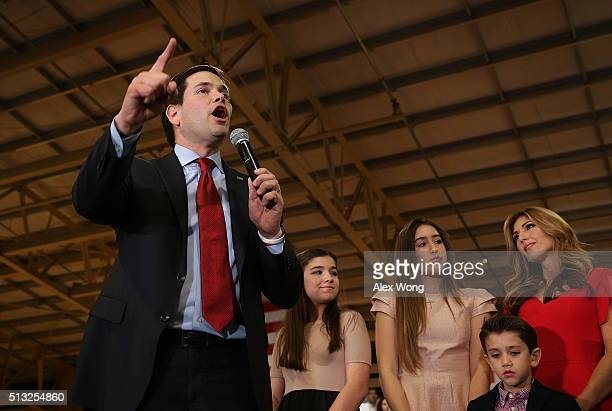 Republican presidential candidate Sen Marco Rubio speaks as daughters Amanda and Daniella son Anthony and wife Jeanette Dousdebes Rubio listen during...