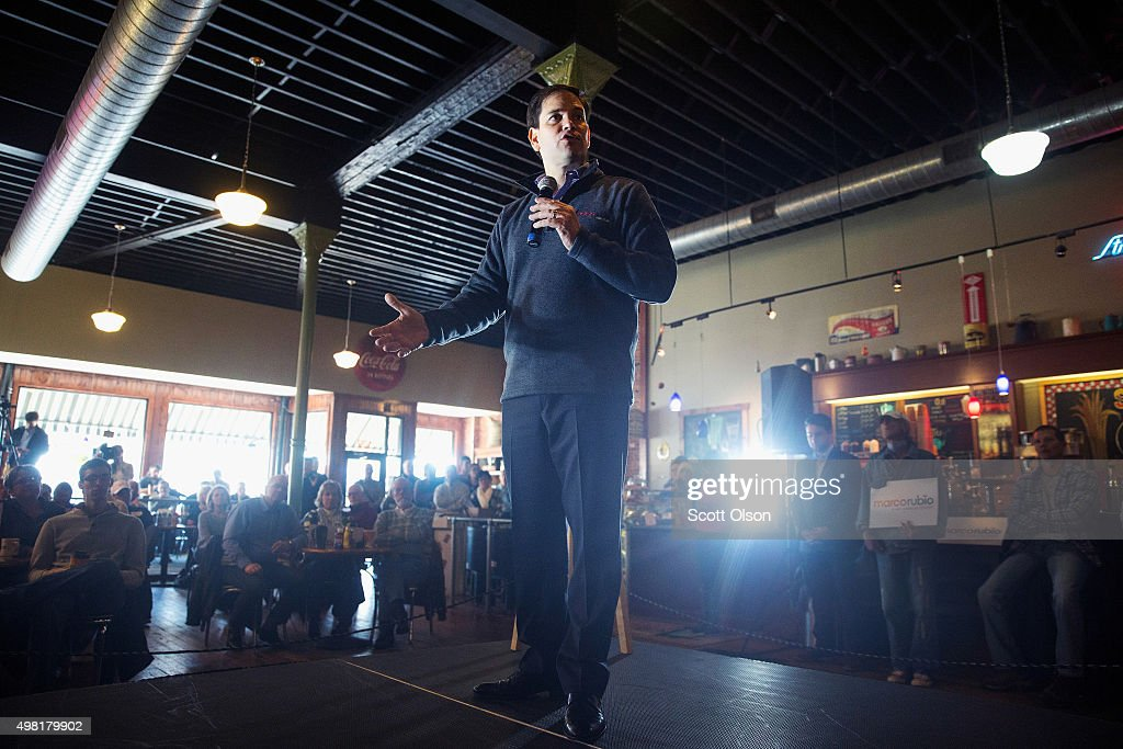 Republican presidential candidate Sen. <a gi-track='captionPersonalityLinkClicked' href=/galleries/search?phrase=Marco+Rubio+-+Politician&family=editorial&specificpeople=11395287 ng-click='$event.stopPropagation()'>Marco Rubio</a> (R-FL) speaks to guests during a campaign stop at Smokey Row Coffee House on November 21, 2015 in Oskaloosa, Iowa. Yesterday Rubio participated in the Presidential Family Forum in Des Moines with six of his Republican rivals for the nomination. Rubio has several campaign stops scheduled in the state today.