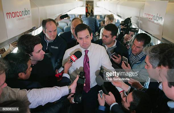 Republican presidential candidate Sen Marco Rubio talks with reporters on his charter flight from ManchesterBoston Regional Airport February 10 2016...