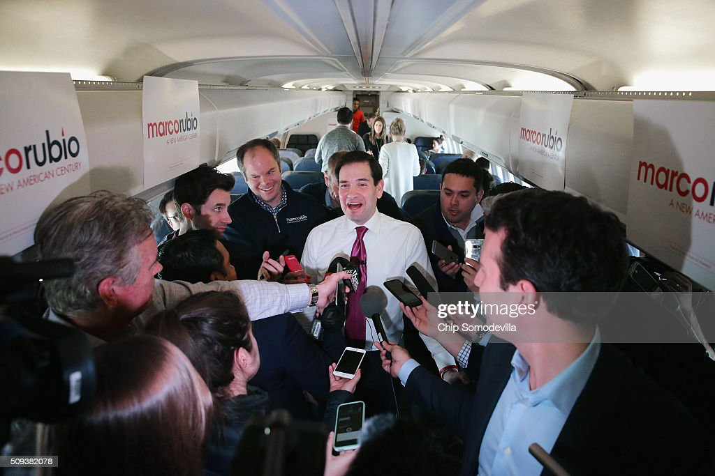 Republican presidential candidate Sen. <a gi-track='captionPersonalityLinkClicked' href=/galleries/search?phrase=Marco+Rubio+-+Politician&family=editorial&specificpeople=11395287 ng-click='$event.stopPropagation()'>Marco Rubio</a> (R-FL) talks with reporters on his charter flight from Manchester-Boston Regional Airport February 10, 2016 en route to Spartanburg, South Carolina. Rubio placed fifth in the New Hampshire primary, behind fellow GOP candidates Jeb Bush, John Kasich, Sen. Ted Cruz (R-TX) and Donald Trump, who swept away the competition with 35-percent of the vote.