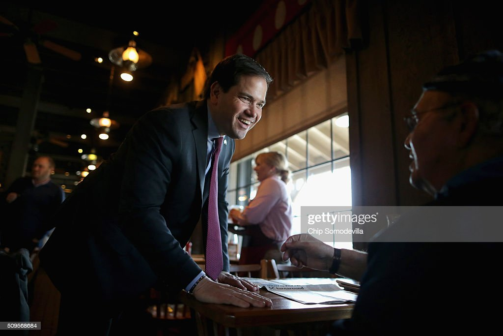 Republican presidential candidate Sen. <a gi-track='captionPersonalityLinkClicked' href=/galleries/search?phrase=Marco+Rubio+-+Politician&family=editorial&specificpeople=11395287 ng-click='$event.stopPropagation()'>Marco Rubio</a> (R-FL) visits with diners while stopping for lunch at the Cracker Barrel Old Country restaurant February 11, 2016 in Myrtle Beach, South Carolina. Earlier in the week Rubio placed fifth in the New Hampshire primary, behind fellow GOP candidates Jeb Bush, John Kasich, Sen. Ted Cruz (R-TX) and Donald Trump, who won with 35 percent of the vote.