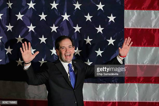 Republican presidential candidate Sen Marco Rubio walks out on stage during a primary election night party at the Radisson hotel February 9 2016 in...