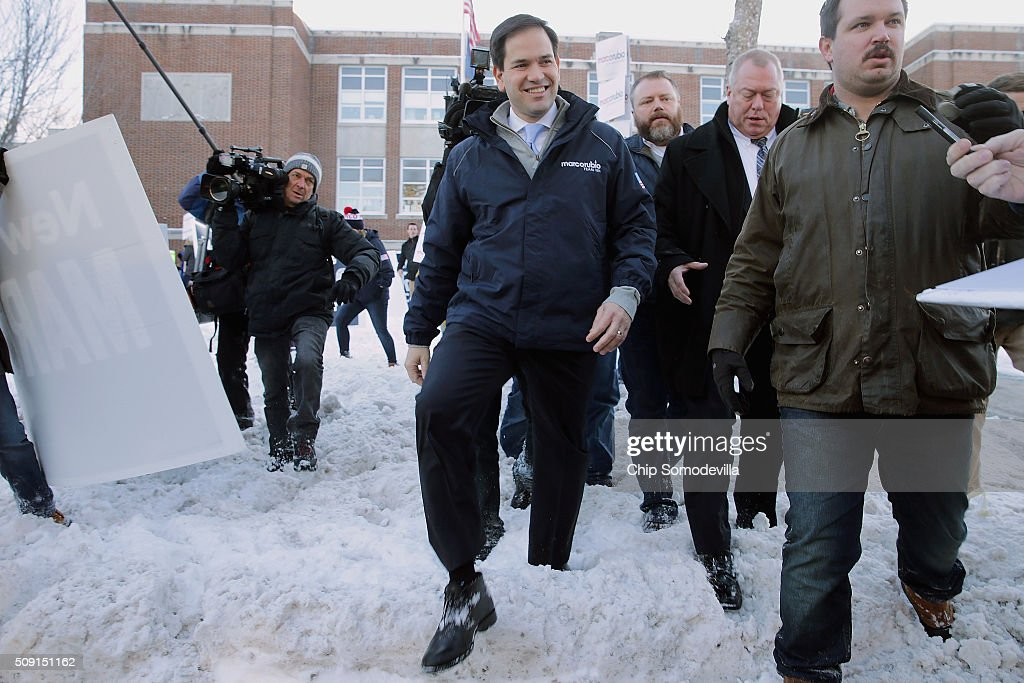 Republican presidential candidate Sen. <a gi-track='captionPersonalityLinkClicked' href=/galleries/search?phrase=Marco+Rubio+-+Homme+politique&family=editorial&specificpeople=11395287 ng-click='$event.stopPropagation()'>Marco Rubio</a> (R-FL) (C) walks through the snow after stopping to thank supporters outside the polling place at Webster School February 9, 2016 in Manchester, New Hampshire. With a good showing in the Iowa caucuses, Rubio has stepped into the crosshairs of fellow Republicans running for president and super PACs that want to slow his momentum with attacks on what they call his robotic and repetative messaging.
