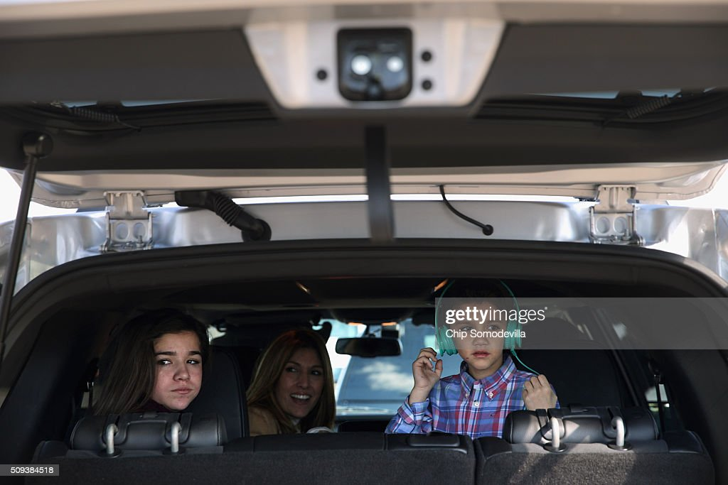 Republican presidential candidate Sen. Marco Rubio's (R-FL) family members (L-R), daughter Daniella, wife Jeanette and son Dominick wait in their vehicle on their way to the next campaign event February 10, 2016 in Spartanburg, South Carolina. Rubio placed fifth in the New Hampshire primary, behind fellow GOP candidates Jeb Bush, John Kasich, Sen. Ted Cruz (R-TX) and Donald Trump, who swept away the competition with 35-percent of the vote.