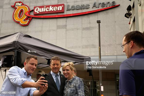 Republican presidential candidate Sen Rand Paul and his wife Kelley Ashby pose for a photograph outside The Quicken Loans Arena August 6 2015 in...