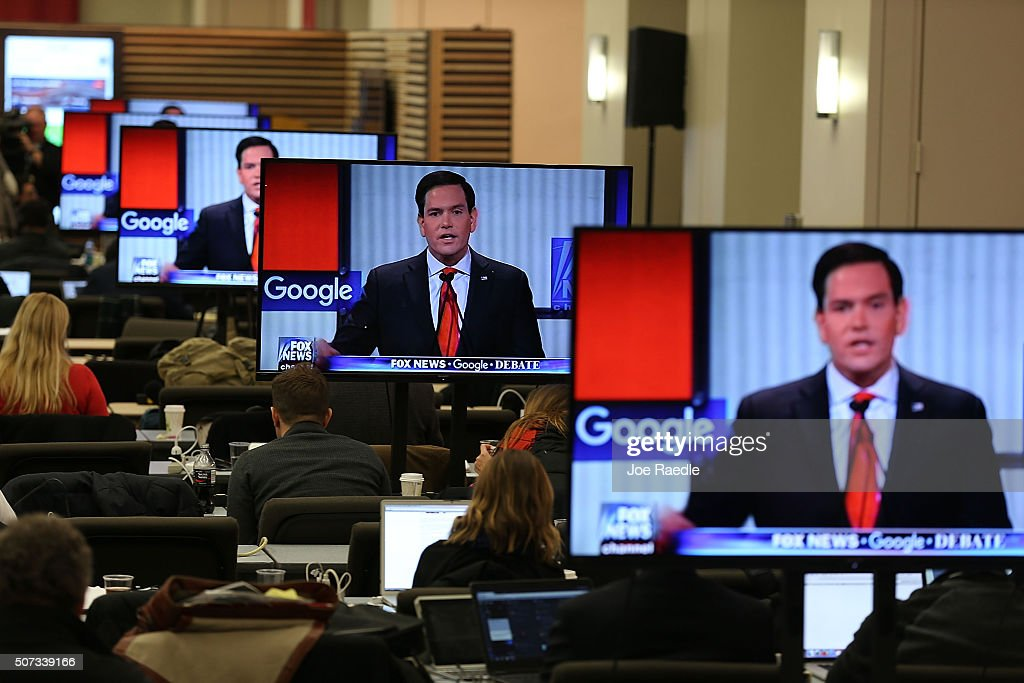 Republican Presidential candidate Sen Sen Marco Rubio is seen on television screens as reporters watch the Republican Presidential debate sponsored...
