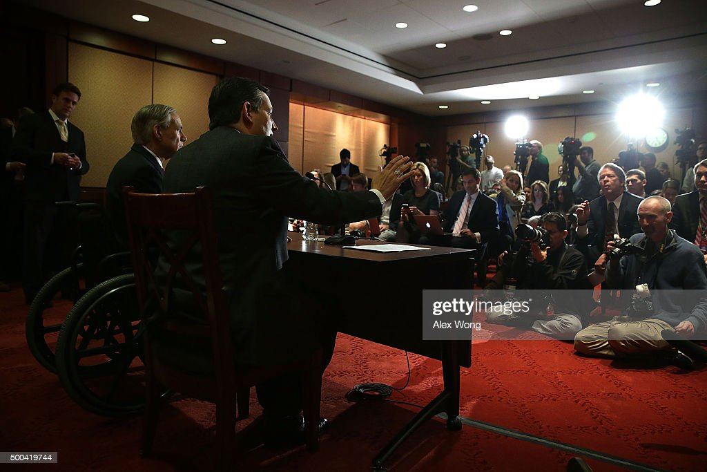 Republican presidential candidate Sen. Ted Cruz (R-TX) (R) and Texas Governor Greg Abbott (L) participate in a news conference December 8, 2015 on Capitol Hill in Washington, DC. Sen. Cruz will introduce legislation addressing the Obama Administration's effort to resettle Syrian refugees in the United States.