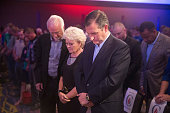 Republican presidential candidate Sen Ted Cruz bows head to pray before the start of his Religious Liberty Rally on August 21 2015 in Des Moines Iowa...
