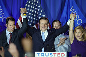 Republican presidential candidate Sen Ted Cruz celebrates with his wife Heidi and Wisconsin Gov Scott Walker at the American Serb Hall Banquet Center...