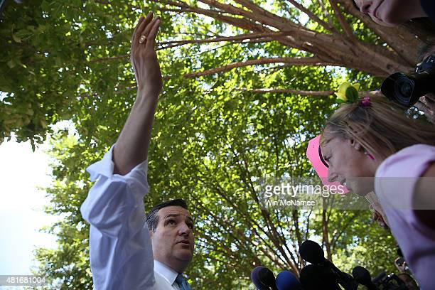 Republican presidential candidate Sen Ted Cruz debates the Iran nuclear deal with Code Pink cofounder Medea Benjamin during a rally in Lafayette...