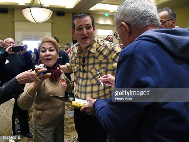 Republican presidential candidate Sen Ted Cruz greets supporters as he arrives at a campaign rally at the Siena Community Center on December 17 2015...