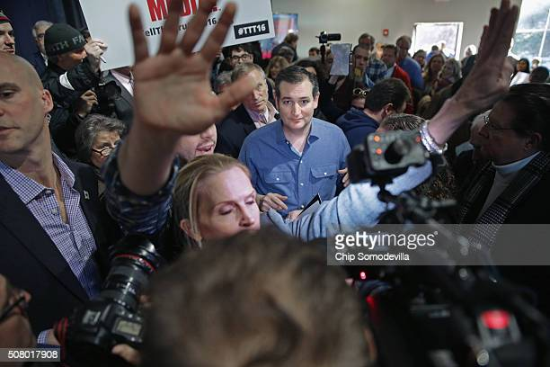 Republican presidential candidate Sen Ted Cruz greets supporters as his staff work to keep journalists back following a campaign town hall meeting at...
