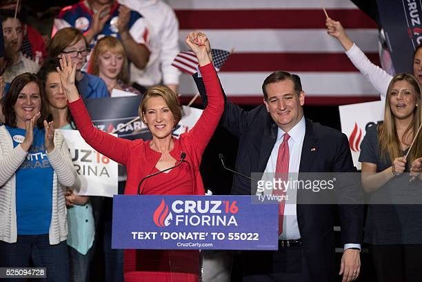 Republican presidential candidate Sen Ted Cruz holds up hands with former HewlettPackard chief executive Carly Fiorina at a campaign rally in the...