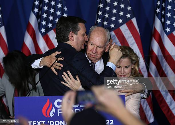 Republican presidential candidate Sen Ted Cruz hugs his father Rafael Cruz and wife Heidi Cruz after announcing the suspension of his campaign during...