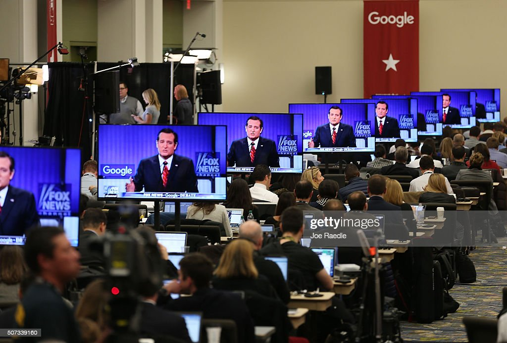Republican Presidential candidate Sen Ted Cruz is seen on a television screen as reporters watch the Republican Presidential debate sponsored by Fox...
