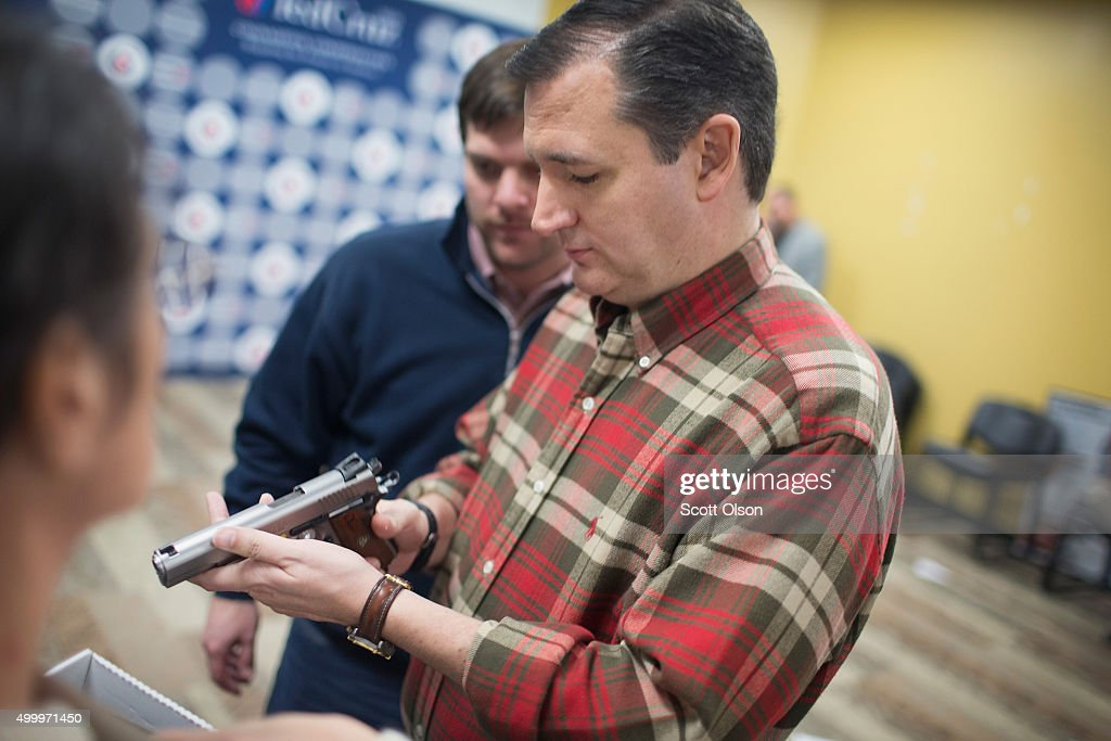 Republican presidential candidate Sen. Ted Cruz (R-TX) looks over a handgun handed to him by a supporter during a campaign event at CrossRoads Shooting Sports gun shop and range on December 4, 2015 in Johnston, Iowa. A recent poll had Cruz tied for third place with Ben Carson and behind Sen. Marco Rubio (R-FL) and front runner Donald Trump in the race for the Republican presidential nomination.