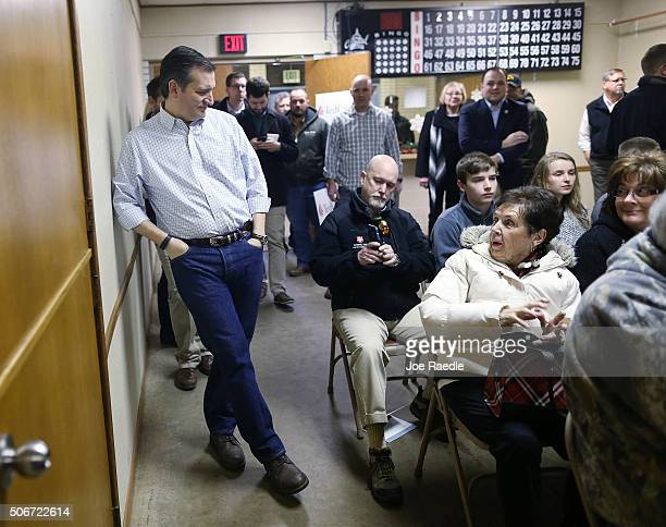 Republican presidential candidate Sen Ted Cruz prepares to greet people after leaning up against the wall as he waits to be introduced during a...