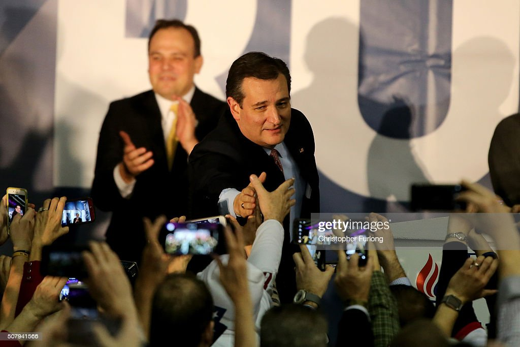 Republican presidential candidate Sen. <a gi-track='captionPersonalityLinkClicked' href=/galleries/search?phrase=Ted+Cruz&family=editorial&specificpeople=7222093 ng-click='$event.stopPropagation()'>Ted Cruz</a> (R-TX) reaches out to supporters after winning at the caucus night gathering at the Iowa State Fairgrounds on February 1, 2016 in Des Moines, Iowa. Cruz beat out businessman Donald Trump and Sen. Marco Rubio (R-FL), who finished just behind Trump.
