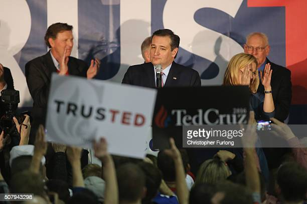 Republican presidential candidate Sen Ted Cruz stands with his wife Heidi as he addresses supporters after winning at the caucus night gathering at...