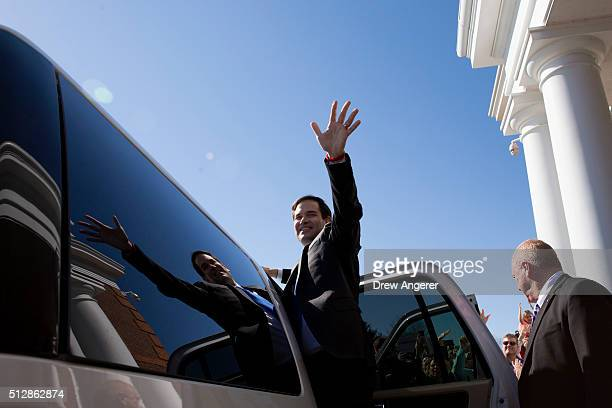 Republican Presidential candidate Senator Marco Rubio waves to onlookers as he gets in his vehicle after speaking at Patrick Henry College February...