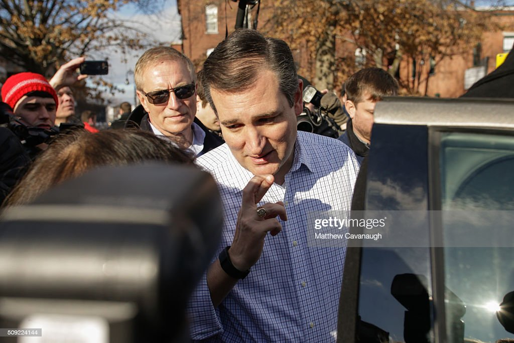 Republican presidential candidate <a gi-track='captionPersonalityLinkClicked' href=/galleries/search?phrase=Ted+Cruz&family=editorial&specificpeople=7222093 ng-click='$event.stopPropagation()'>Ted Cruz</a> crosses his fingers as he speaks to a supporter following a campaign stop on February 9, 2016 at the Red Arrow Diner in Manchester, NH. Voters throughout the state are heading to the polls as the New Hampshire Primary, also known as the first-in-the-nation primary, continues the process of selecting the next president of the United States.
