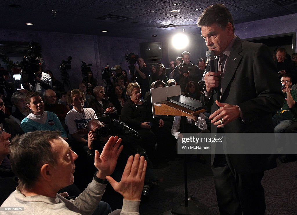 Republican presidential candidate Texas Gov. Rick Perry answers questions from Iowa voters at Doughy Joey's pizza shop December 30, 2011 in Waterloo, Iowa. Four full days of campaigning remain before Iowans vote on January 3rd.