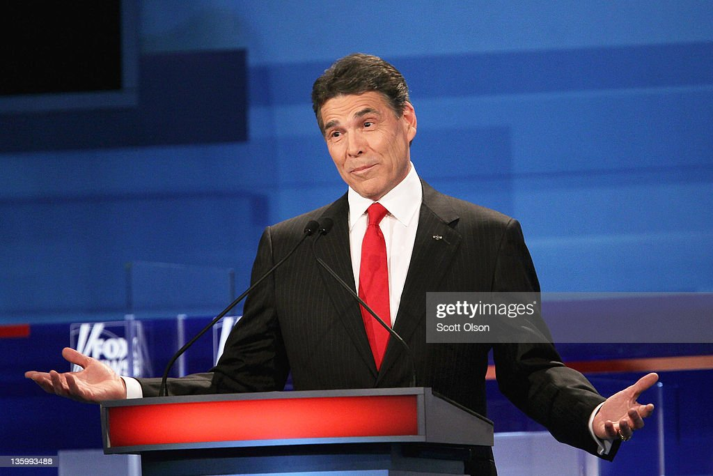 Republican presidential candidate Texas Gov. Rick Perry fields a question during the Fox News Channel debate at the Sioux City Convention Center on December 15, 2011 in Sioux City, Iowa. The GOP contenders are in the final stretch of campaigning in Iowa where the January 3rd caucus is the first test the candidates must face before becoming the Republican presidential nominee.