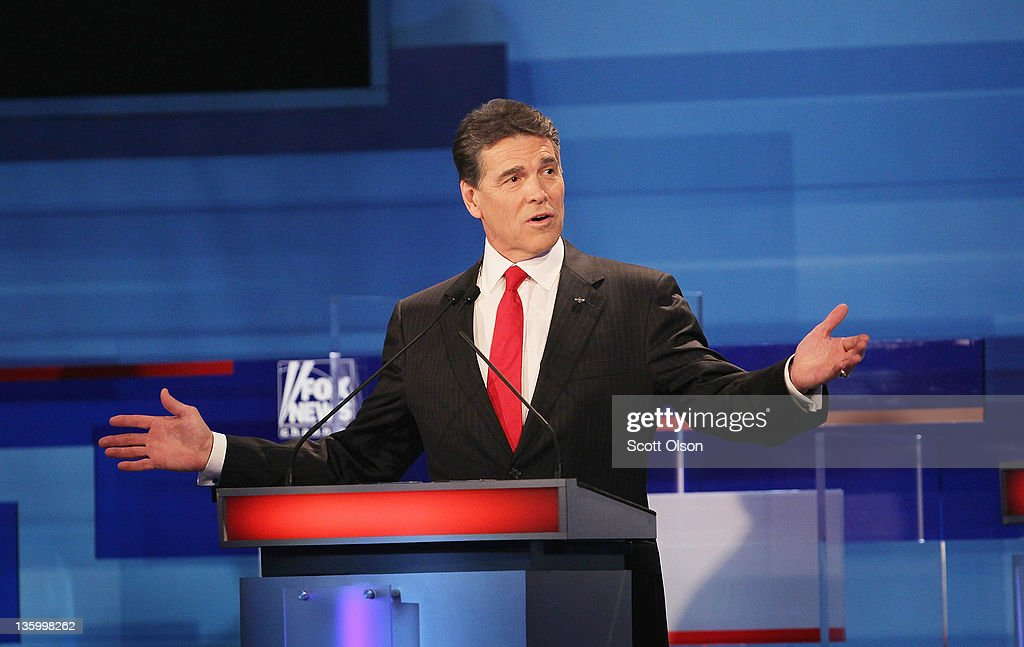 Republican presidential candidate (L-R) Texas Gov. <a gi-track='captionPersonalityLinkClicked' href=/galleries/search?phrase=Rick+Perry+-+Politician&family=editorial&specificpeople=175872 ng-click='$event.stopPropagation()'>Rick Perry</a> fields a question during the Fox News Channel debate at the Sioux City Convention Center on December 15, 2011 in Sioux City, Iowa. The GOP contenders are in the final stretch of campaigning in Iowa where the January 3rd caucus is the first test the candidates must face before becoming the Republican presidential nominee.