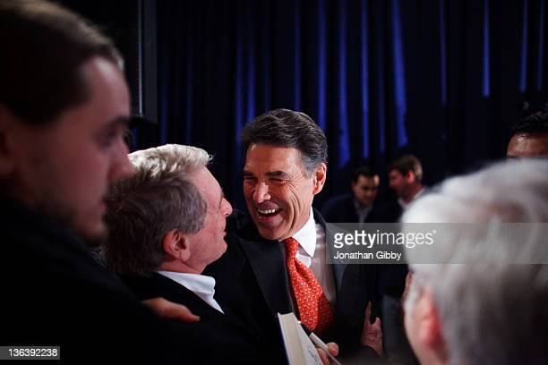 Republican presidential candidate Texas Gov Rick Perry greets supporters after hearing the results of the Iowa caucus at the Sheraton January 3 2012...