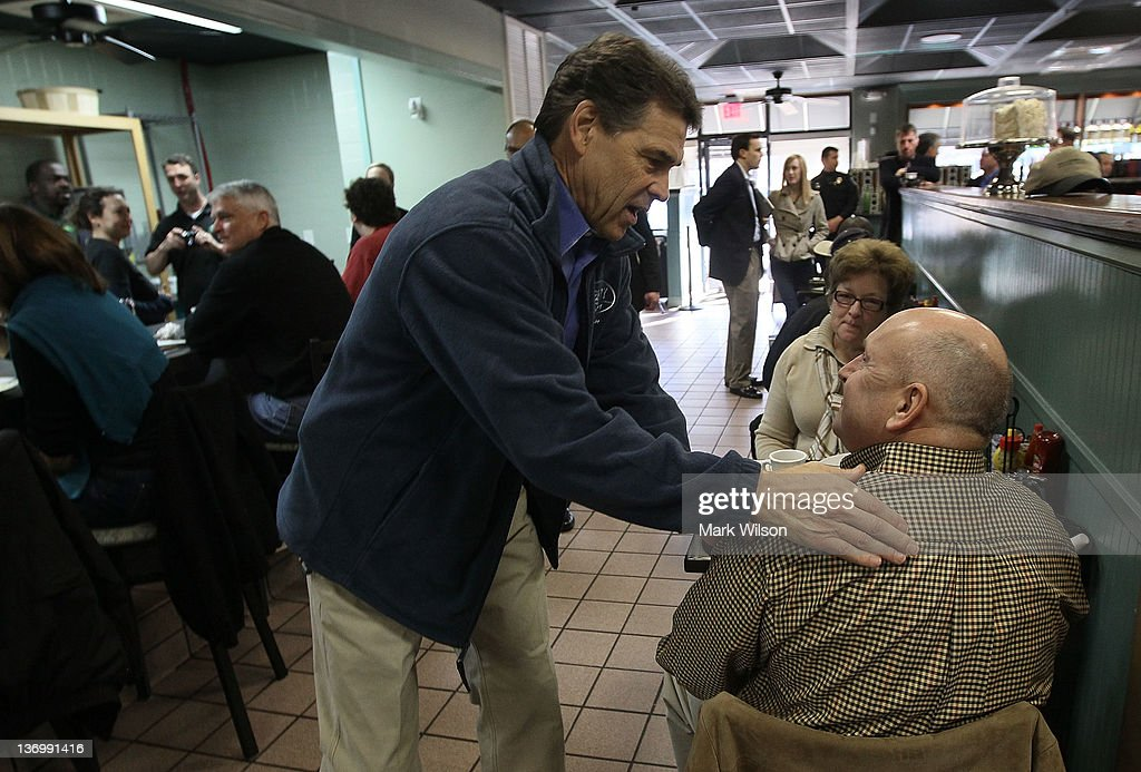 Republican presidential candidate, Texas Gov. <a gi-track='captionPersonalityLinkClicked' href=/galleries/search?phrase=Rick+Perry+-+Politician&family=editorial&specificpeople=175872 ng-click='$event.stopPropagation()'>Rick Perry</a> greets supporters at Page's Okra Grill January 14, 2012 in Mt. Pleasant, South Carolina. Voters in South Carolina will head to the polls on January 21st. to vote in the primary election to pick their choice for U.S. presidential candidate.