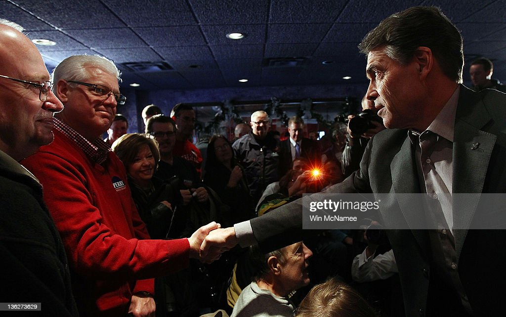 Republican presidential candidate Texas Gov. Rick Perry greets Iowa voters after speaking at Doughy Joey's December 30, 2011 in Waterloo, Iowa. Four full days of campaigning remain before Iowans vote on January 3rd.